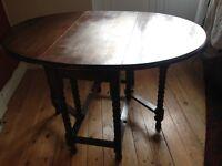 Dark mahogany gate-leg dining table