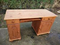 Pine desk with keyboard shelf, drawers, cabinets