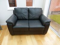 2 Seater Black Faux Leather Sofa - Excellent Condition - Very Little Use