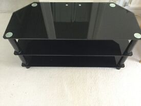 TV Stand. Black glass with chrome. 105cm wide, 45cm deep, 50cm height. Nice condition.