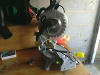 Mitre saw with cutting blade and protective guard very good condition good working order