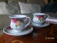 Pair of tea cups and saucers .