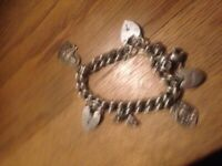 Silver bracellet and charms