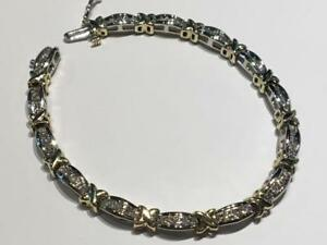 #3456 10K YELLOW AND WHITE GOLD DIAMOND TENNIS BRACELET 7 IN LENGTH. APPRAISED FOR $4150.00 SELL FOR $1350.00!