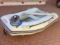 New Sun Sport dinghy with new Mercury outboard