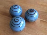 Three ceramic balls