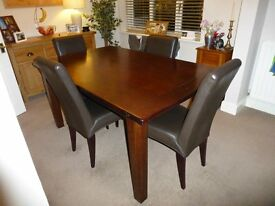 Solid dark wood dining room table and chairs
