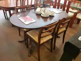 Extendable table and 4 pattern striped chairs