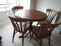 Dining table and 4 chairs in wood