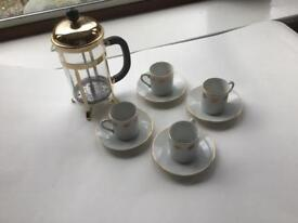 Gold coloured Pyrex cafetière and espresso cups and saucers