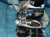 Two pairs of junior cricket shoes