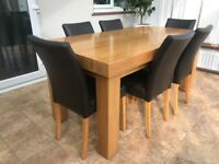 Solid chunky oak dining table and chairs