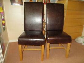 PAIR OF BROWN LEATHER DINING CHAIRS. IN EXCELLENT CONDITION