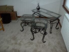 As new set of three wrought iron tables with glass tops