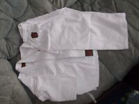 2 PAIRS PLAYWELL KARATE SUITS IN WHITE...........SIZE 00/120 AND 1/40(6-8 yrs and 10-12yrs)