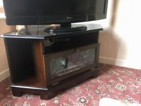 Mahogany television table with glass front