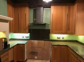 Good quality second hand kitchen with oak doors and granite worktops..