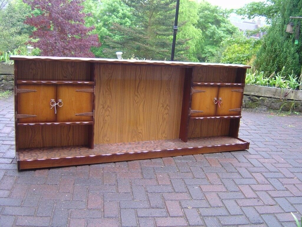 Long fire surround with 2 side cupboards,