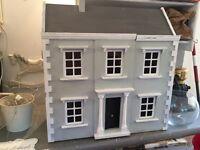 A stunning vintage dolls house