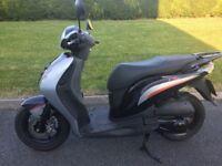 Honda PS125i moped for sale.