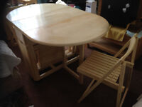 Lovely space saving folding table and chairs for sale, light coloured solid wood