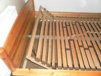 A double bed made of pine solid wood