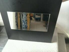 Lovely mirror with black wood background