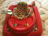 Hi, here we have a very nice baby walker , two hight settings. In very good condition
