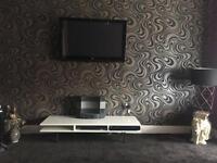 Modern white high gloss tv and audio unit