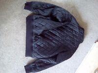 """mckenzie older boys jacket 12 to 14 yrs. Chest size 36"""" in black."""