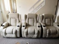 Cream leather recliner with electric message