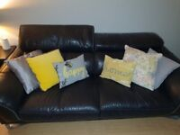 Dfs Black leather sofas and pouffe