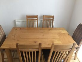 Solid oak wood extending dining table with chairs