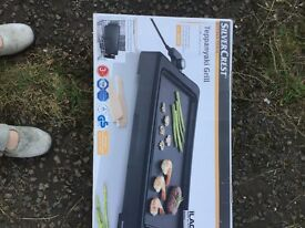 Grill tepanyaki grill brand new in box. It was bought and has never been used.