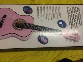 Pink classical wooden guitar