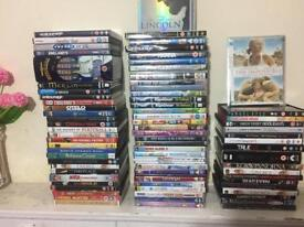Approximately 90 movie DVD's and some pc games cd's for sale.