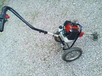 Wheeled petrol strimmer