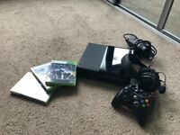 Black Xbox 360 E ( barely used & fully functioning )