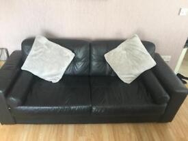 3 seater black sofa and cushions