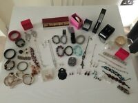 Car boot bundle of 269 items including Gucci sunglasses, clothes, cosmetics, jewellery and books