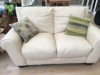 Two 2 seater leather cream sofas. Very good condition, comes with 4 scatter cushions if required.