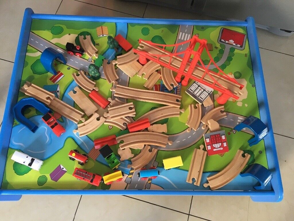 Train table with full set of track trains and extra cars etc brand new condition