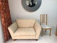 2 seater love seat in beige, cream and light brown circular fabric pattern (M&S)
