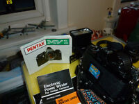 Pentax 35mm camera complete with 3 lenses and flash and strap and auto winder