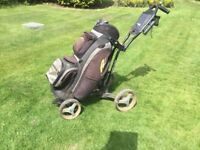 Sun mountain micro cart golf trolley and golf bag .