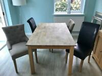 Solid oak extending dining table with 4 chairs, seats 6.