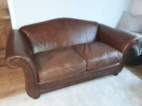 Leather settee, by Laura Ashley