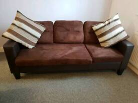 Three seater sofa with foot stool.