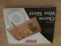 Wooden cheese board with wire slicer