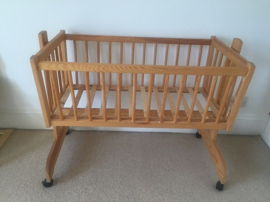 Swinging crib with matress